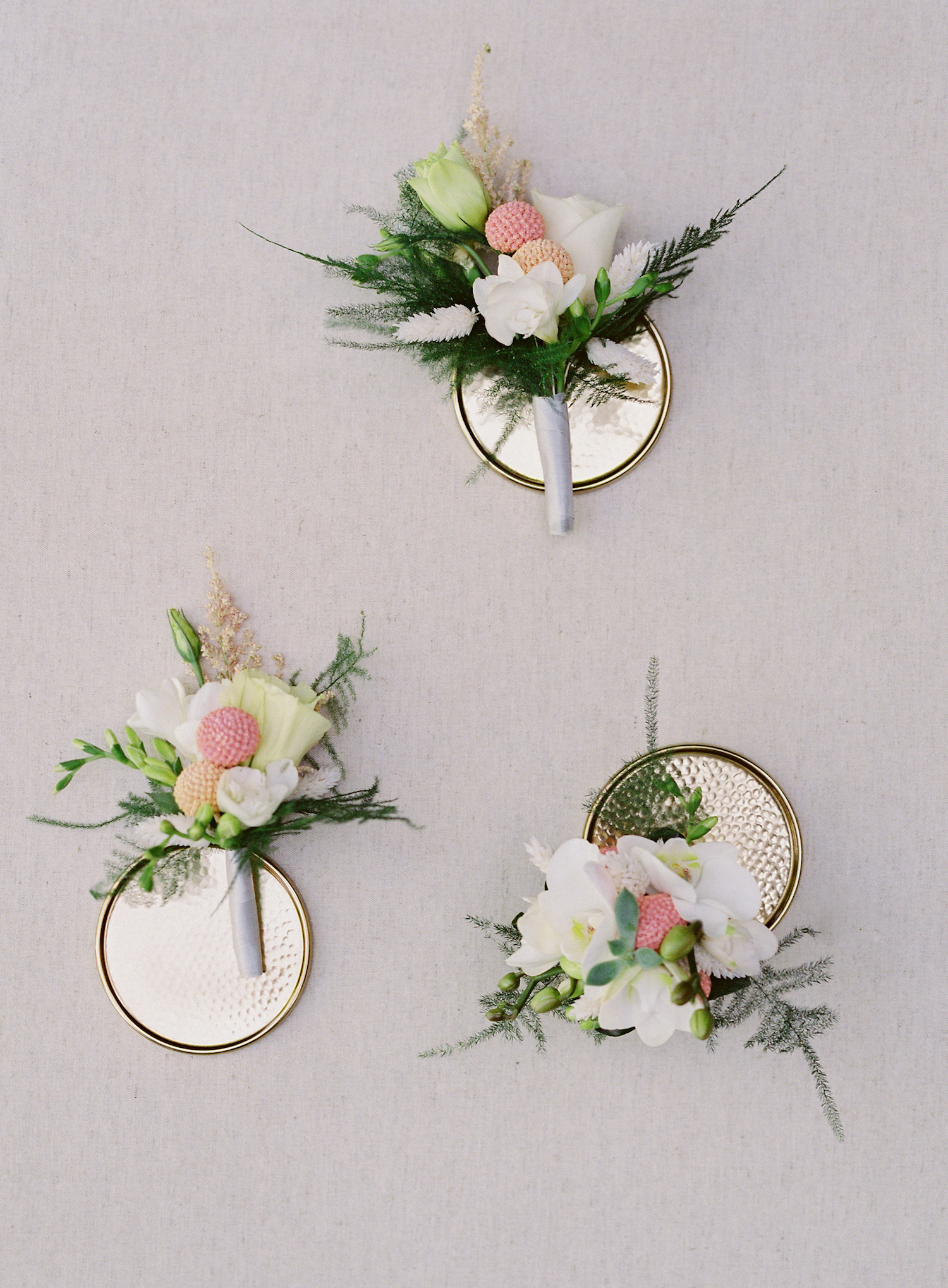 blush-and-white-boutonnieres