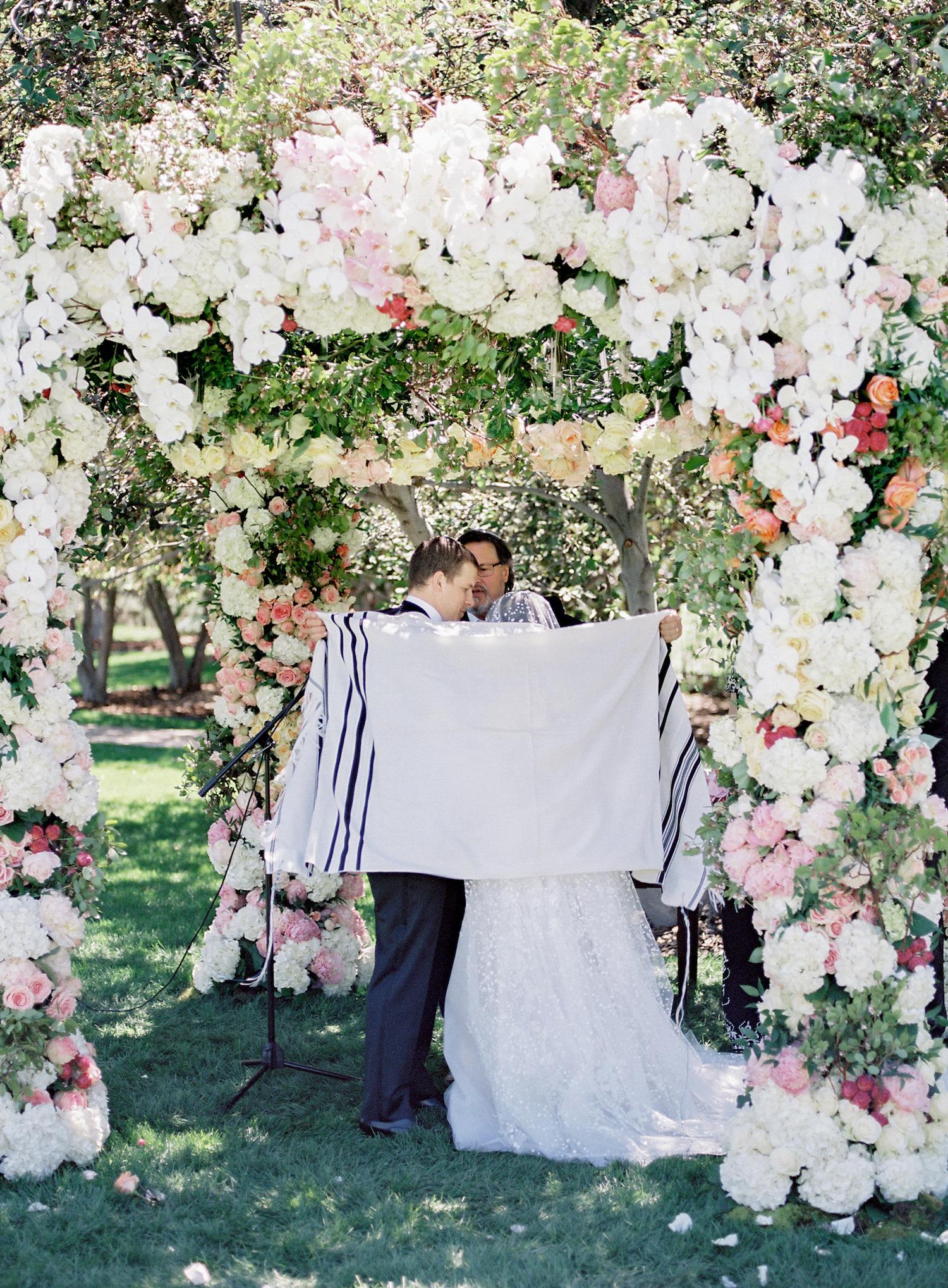 micro-wedding-garden-jewish-ceremony-under-floral-chuppah